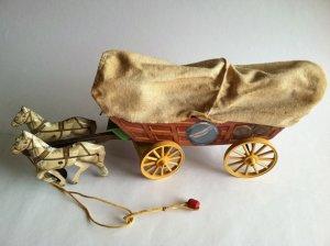 Vintage tin horse-drawn Conestoga wagon Photo courtesy of RedRavenCollectibles on Etsy