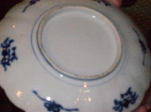Genuine early 18th Century Imari. Note the lack of a mark on the underside.