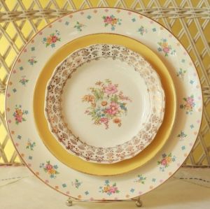 Coordinated vintage items often look more interesting than a perfectly matched set. Photo courtesy of FancifulTableware, Etsy
