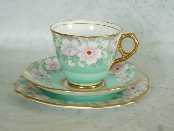 English bone china teacup and saucer. Photo courtesy of Swirling Orange 11, Etsy