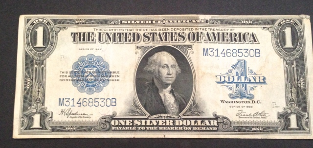This bill has a Speelman and White signature. But it also has a blue seal, and it isn't in uncirculated condition.