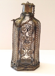 A perfume bottle? Vinegar, to go with the cruets? Who knows?
