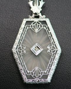 Antique White Gold Camphor Glass and Diamond Filigree Pendant Photo courtesy of The Copper Canary, Etsy